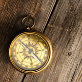 Antique compass over wooden background Royalty Free Stock Images