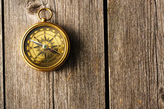 Antique compass over wooden background Stock Photo