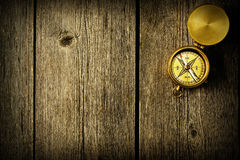 Antique compass over wooden background Stock Image