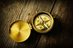 Antique compass over wooden background Royalty Free Stock Photos