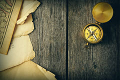 Antique compass over wooden background Royalty Free Stock Photography
