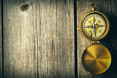 Antique compass over wooden background Stock Photos