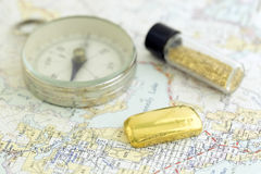 Antique Compass, Prospecting Map, And Gold Royalty Free Stock Photography
