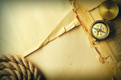 Antique compass and rope over old map Royalty Free Stock Images
