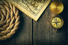 Antique compass and rope over old map Stock Image