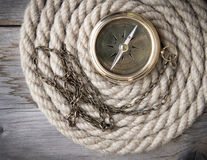 Antique compass and rope Stock Photos