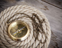 Antique compass and rope Stock Photography