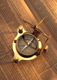 Antique compass on stock index Royalty Free Stock Photos