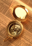 Antique compass on stock index Royalty Free Stock Photo
