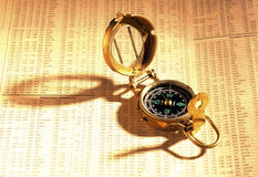 Antique compass on stock index Royalty Free Stock Photography