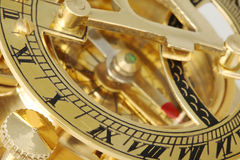 Antique compass with sundial. Royalty Free Stock Photography