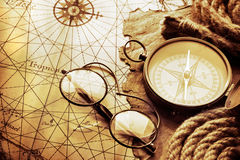 Antique compass on vintage map Royalty Free Stock Photo