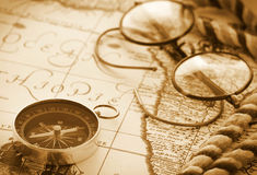 Antique compass on vintage map Stock Image