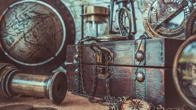 Antique Compass, Watch Necklace, Telescope, Wooden Treasure Box And Globe Model Pirate Collection Photos stock photos
