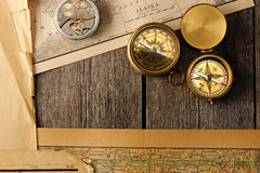 Antique compasses over old map Royalty Free Stock Images