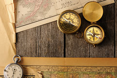 Antique compasses over old map Stock Photo