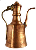 Antique copper coffee pot. Old-fashioned copper handle coffeepot isolated on white background Royalty Free Stock Photos