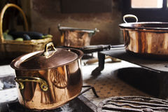 Antique copper cooking pans Royalty Free Stock Image