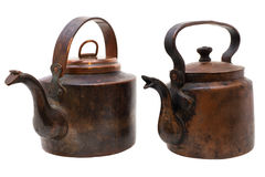Antique copper kettles isolated on white Royalty Free Stock Images