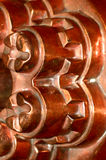 Antique copper mould mold. Industrial screw fitting pattern as seen on an antique cookery pan, mold, mould Stock Images