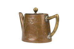 Antique copper teapot on white Stock Images