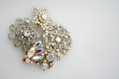 Antique Costume Jewelry. Four pieces of antique costume jewelry are grouped together in a cluster leaving room to the right of the group for text Stock Images