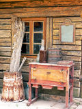 Antique cottage. Part of the old country cottage. A view at wooden wall with window and the antique items Stock Photography