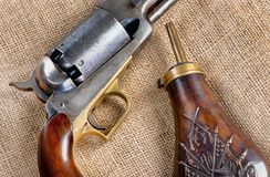 Antique Cowboy Pistol and Gunpowder Flask. Antique Cowboy percussion pistol and  copper gunpowder flask stock photos