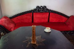 Antique cozy sofa in room. Close up oriental style sofa with cushions in room part of interior Stock Photo