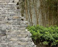 Antique cracked brick wall. Chinese traditional brick wall in garden Stock Photos
