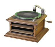Antique crank phonograph isolated. Antique hand-crank wound phonograph in a wood box with volume louvers.  Isolated on white Royalty Free Stock Photography