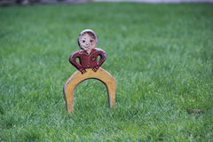 Antique croquet wicket. Vintage croquet wickets. Wicket is a boy in pants and jacket Royalty Free Stock Photography