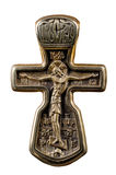 Antique crucifix. Ancient Orthodox crucifix of yellow metal Royalty Free Stock Image