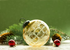 Antique Crystal Christmas Ornament. Antique amber cut glass Christmas ornament with spruce and cones royalty free stock photo