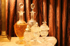 Antique crystal decanters. Beautiful antique european crystal decanters some filled with liquor Royalty Free Stock Photos