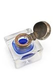 Antique crystal inkwell with blue ink Royalty Free Stock Image