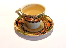 Antique cup and saucer Royalty Free Stock Image