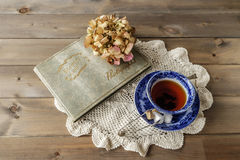 Antique cup and saucer with tea on lace cloth Royalty Free Stock Photo