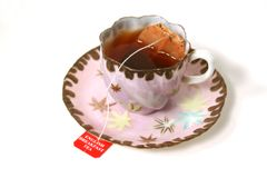 Antique cup with tea bag. stock photography