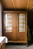 Antique cupboard in a room Stock Image