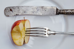 Antique cutlery and apple Royalty Free Stock Photos