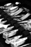 Antique cutlery. A canteen of antique silver cutlery on display Stock Photography