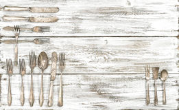 Antique cutlery rustic wooden background kitchen utensils Royalty Free Stock Photos