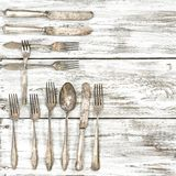 Antique cutlery rustic wooden background Knife fork spoon. Antique cutlery on rustic wooden background. Knife, fork and spoon royalty free stock images