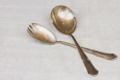 Antique cutlery - spoon and fork Royalty Free Stock Photography