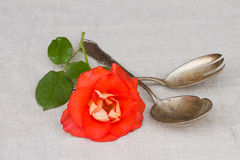 Antique cutlery - spoon and fork with rose Stock Image