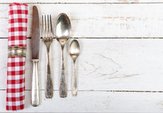 Antique cutlery and towel Royalty Free Stock Photography