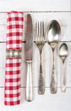 Antique cutlery and towel Stock Image