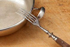 Antique cutlery. On a wooden board Stock Photo