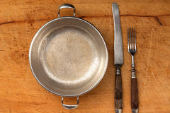 Antique cutlery. On a wooden board Royalty Free Stock Images